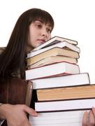 Stock Photo of clever girl with heap book.