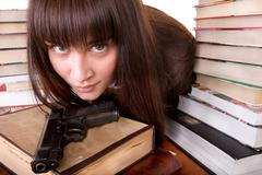 girl with heap book and weapon. - stock photo