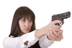 Beautiful young women with gun. Stock Photos