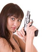 beautiful young women with gun. - stock photo