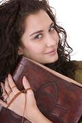 Stock Photo of clever woman with old book.