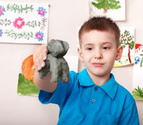 Kid playing with clay. Stock Photos