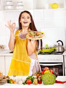 Woman cooking pizza. Stock Photos