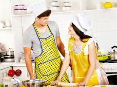 Young cook cooking at kitchen. Stock Photos