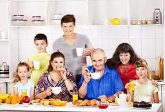 big happy family have breakfast. - stock photo