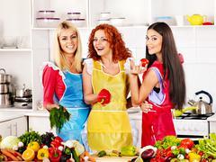 Stock Photo of group women preparing food at kitchen.