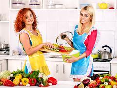 group women preparing food at kitchen. - stock photo