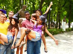 Stock Photo of group of people outdoors.