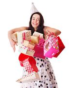 Stock Photo of woman holding gift box at birthday party.