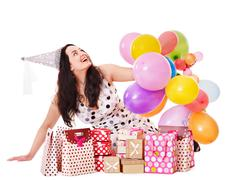 Woman holding gift box at birthday party. Stock Photos