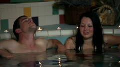 Couple in love soaking in a hot pool Stock Footage