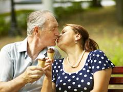 happy old couple with ice-cream. - stock photo