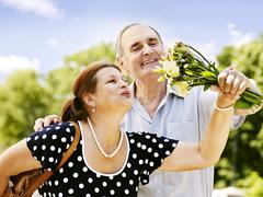 happy old couple outdoor. - stock photo