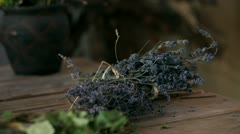 Close up of a hand setting a decoration of lavander on table - stock footage