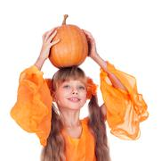girl in orange long dress with pumpkin  at thanksgiving. - stock photo
