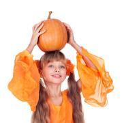 Girl in orange long dress with pumpkin  at thanksgiving. Stock Photos