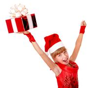 girl child santa clause in red dress with gift box. - stock photo