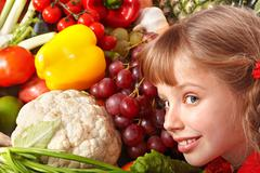child girl with group of vegetable and fruit. - stock photo