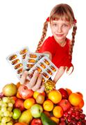 child with fruit and vitamin pill. - stock photo