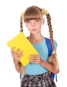 Stock Photo of child with backpack holding book.