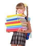 Stock Photo of schoolgirl with backpack holding books.