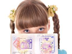 Stock Photo of child holding  passport.
