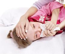 Sick child with handkerchief in bed. Stock Photos