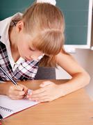 schoolchild near blackboard. - stock photo