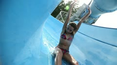 Small girl on a water slide Stock Footage