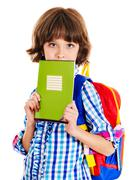 Stock Photo of child with stack of books.