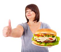 woman eating hamburger. - stock photo