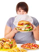 woman refusing fast food. - stock photo