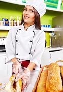 Stock Photo of female chef holding  food.