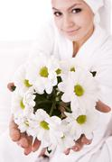Girl with camomile and white towel on head . Stock Photos