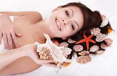 Beauty young woman holding starfish. Stock Photos