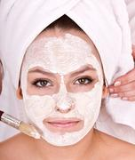 Cosmetician make  mask to  girl.  massage. Stock Photos