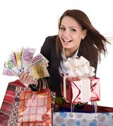 Stock Photo of business woman with money, gift  box and bag.