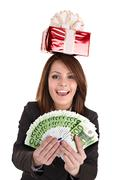 Business woman with money,red christmas box. Stock Photos