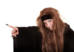 Witch in black costume and long hair point claw finger. Stock Photos