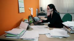 Business woman making a call at work Stock Footage