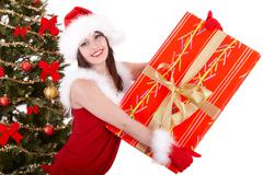 christmas girl and fir tree with red gift box. - stock photo