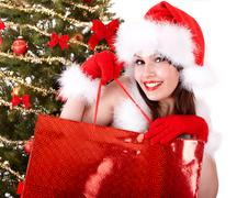 Christmas  shopping of girl in santa hat, fir tree. Stock Photos