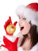 Face of christmas girl in santa hat. Stock Photos