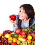 girl with group of fruit and vegetables. - stock photo