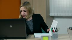 Medium shot of CEO working in office while interviewee arrives - stock footage