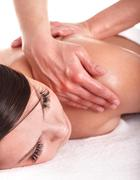 girl having back massage. - stock photo