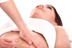 Stock Photo of young woman having stomach massage.