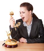 aggressive businesswoman with phone. - stock photo