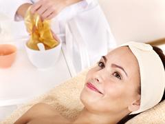Stock Photo of girl with gold facial mask.