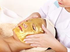 girl with gold facial mask. - stock photo